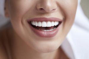 Healthy white smile close up. Beauty woman with perfect smile